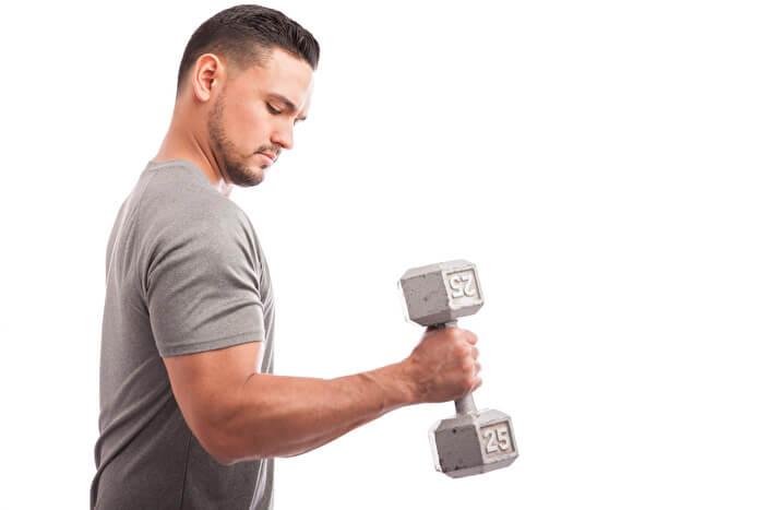 ①肘を固定する